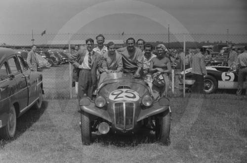 Car number 25, David Clarke and Peter Scott-Russell in Frazer Nash Le Mans Replica. Grand Prix driver Bob Gerard standing (spectacles) left.