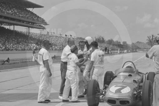 Len Sutton surrounded by crew members after getting out of car number 7, a Watson.