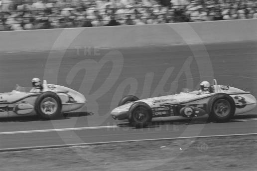 Car number 1, a Trevis, driven by A. J. Foyt. Car number 3, a Watson, driven by Roger Ward.